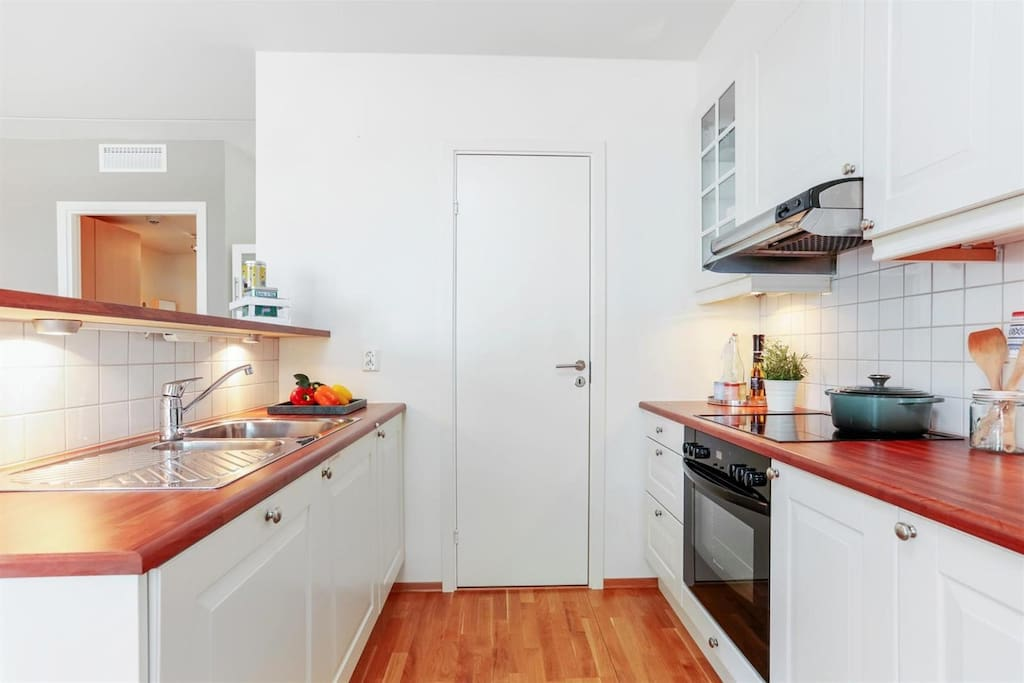 Kitchen with microwave, dishwasher, oven, freeser and fridge