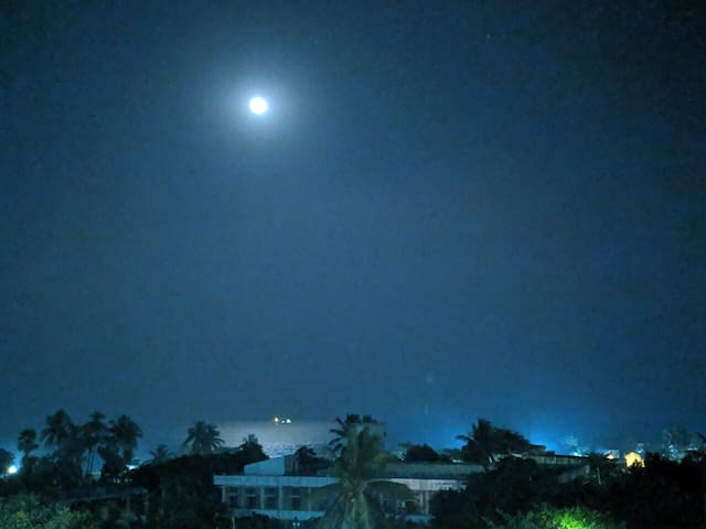 Beach view from the room on a full moon night