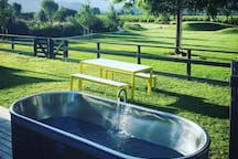 Outdoor Bath for relaxing and watching sunsets with a complimentary bottle of wine