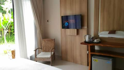 Cozy room near the beach with garden view