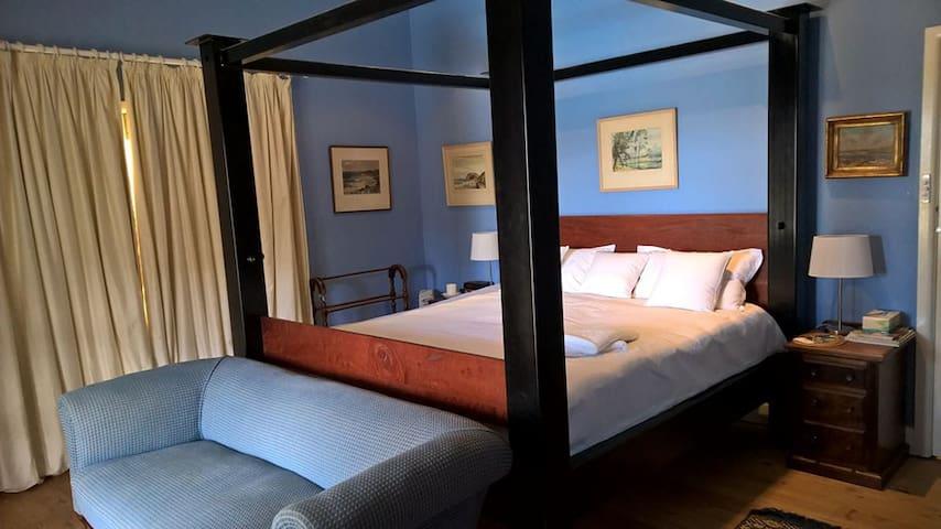 Bedroom 1 King size master bed room with doors opening onto verandah