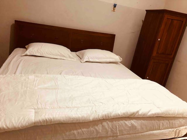 Main bed room with king size jati solid wood, with shower room inside bed room