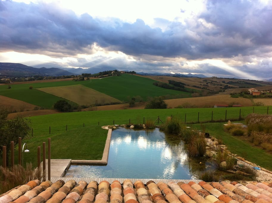 View from master bedroom overlooking pool and countryside.