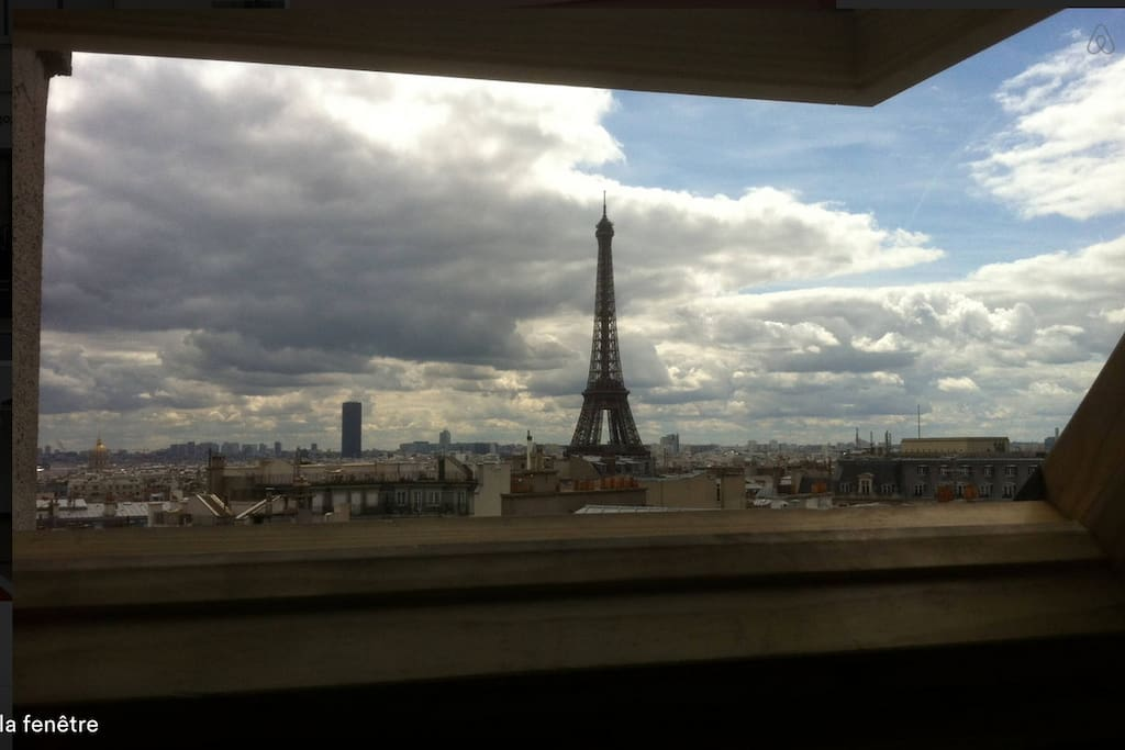 the Eiffel Tower through the window