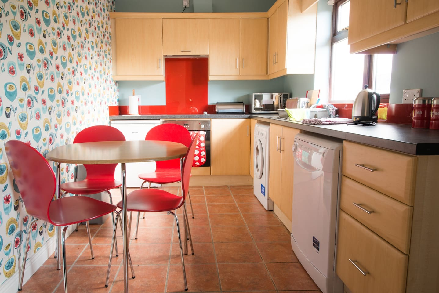 Fully fitted well equipped kitchen has crockery and utensils with oven, hob, microwave, dishwasher, washer/drier.