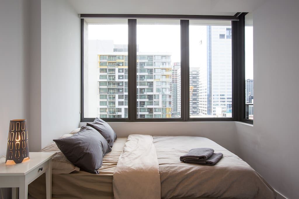 A bedroom with a stunning view of the CBD.
