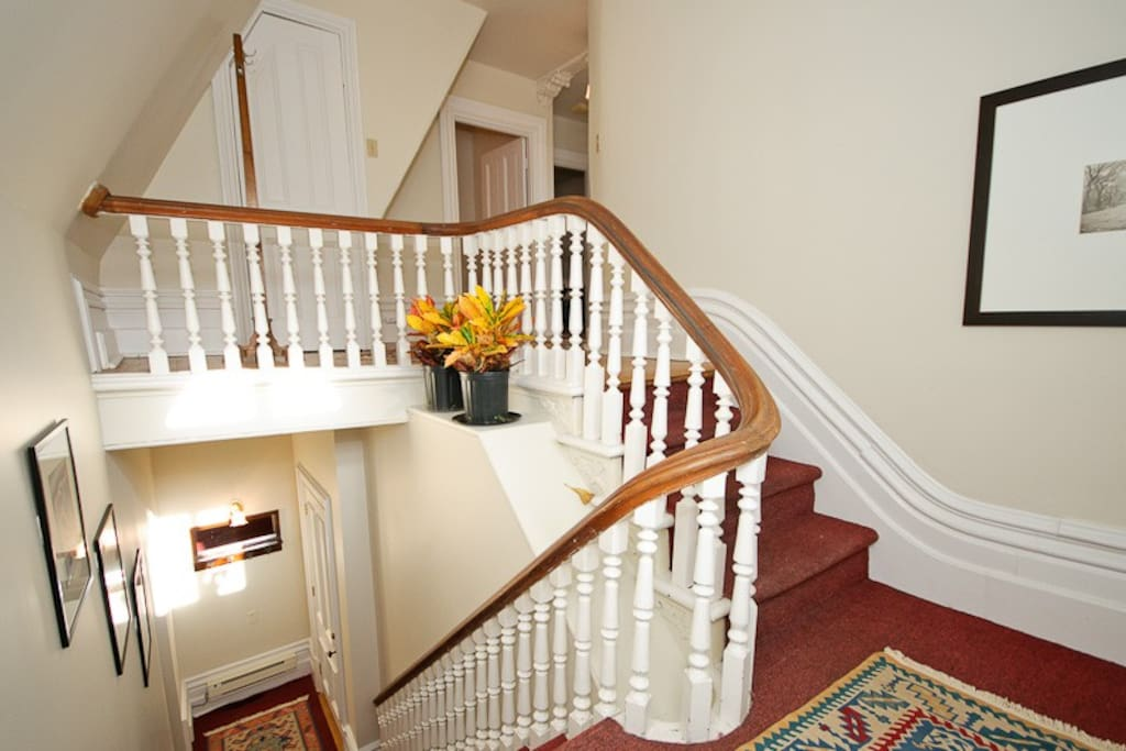 Private entrance and grand staircase to your suite.