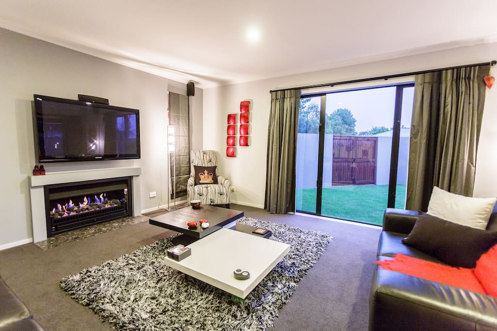 Separate formal lounge for privacy if required, with large TV, gas heating