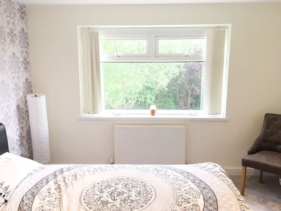 Large windows allowing natural light to flood the bedroom