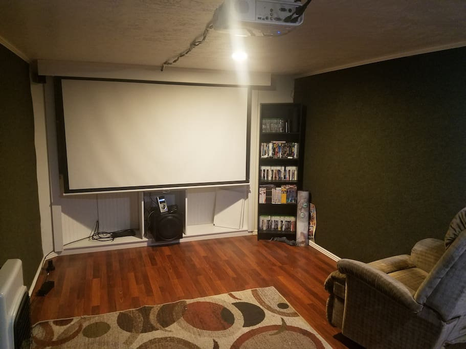 Also in the theater is a home entertainment center with projector and surround sound.