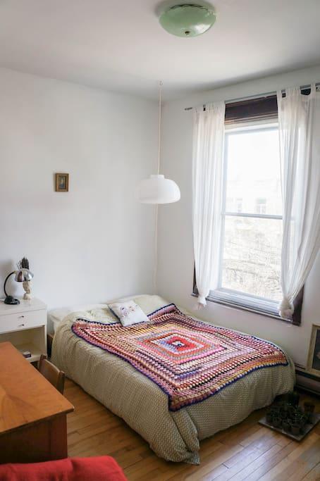Sunny bedroom with balcony