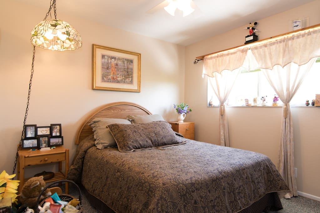 The golden room has comfortable queen size bed with fresh clean linens, cloths closet, and small dresser