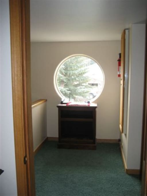 2nd floor landing with views of the mountains and a convenient hideway ironing board