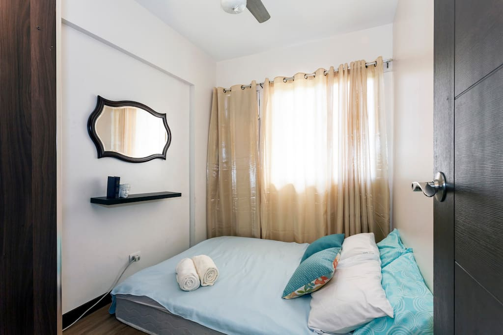 Second bedroom soft queen sized beds with aircon