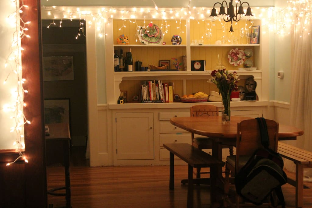 Dine with family and friends in our cozy dining room. Easily sits 8 people and you can extend it with an extra table leaf if necessary. Great cookbooks to inspire your meals.