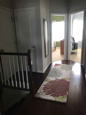 Hallway to bedroom, bathroom and laundry room.