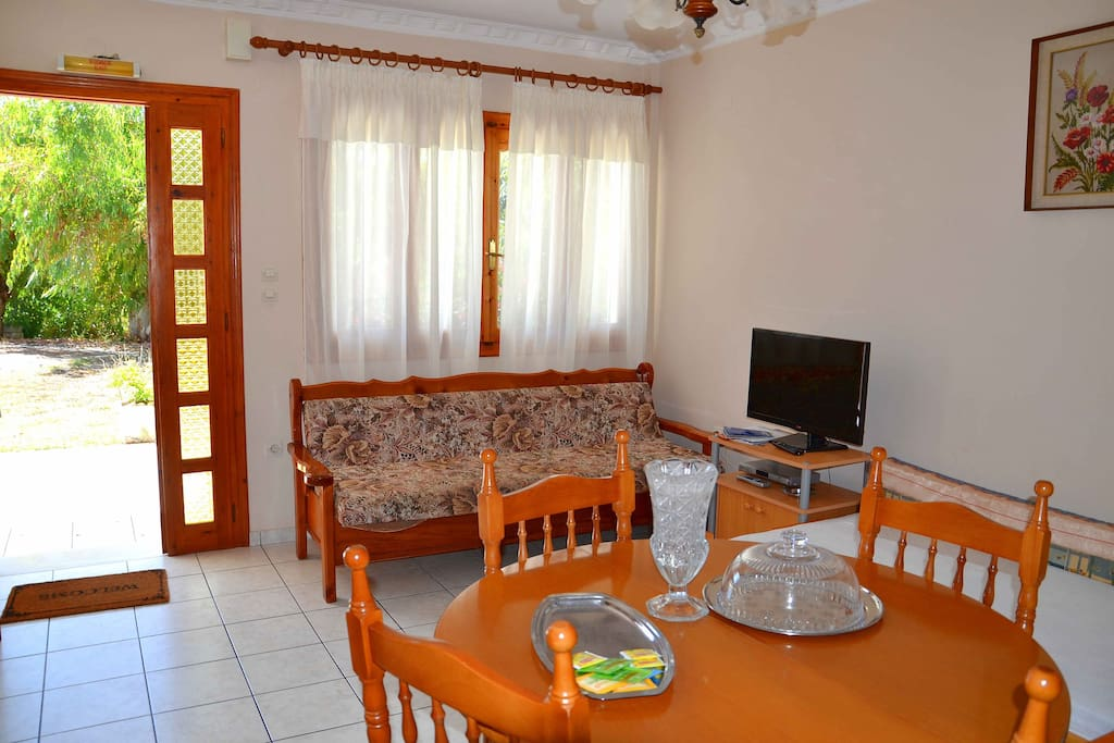 The living room is spacious enough: you will find here 2 sofas, dining table, kitchenette