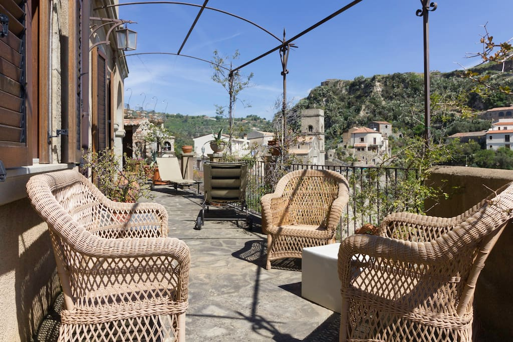 Wrap around terrace with sweeping views to the medieval town, the. valley,  the sea and Calabria in the distance.