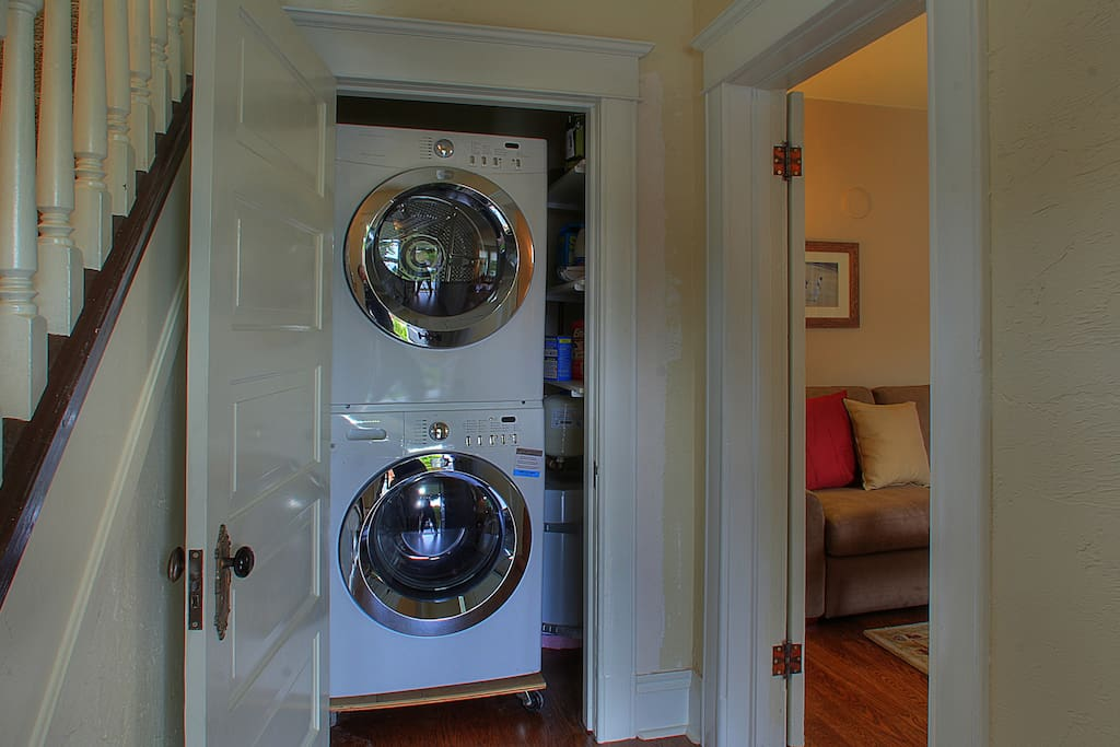 Full-size laundry shared with upper apartment
