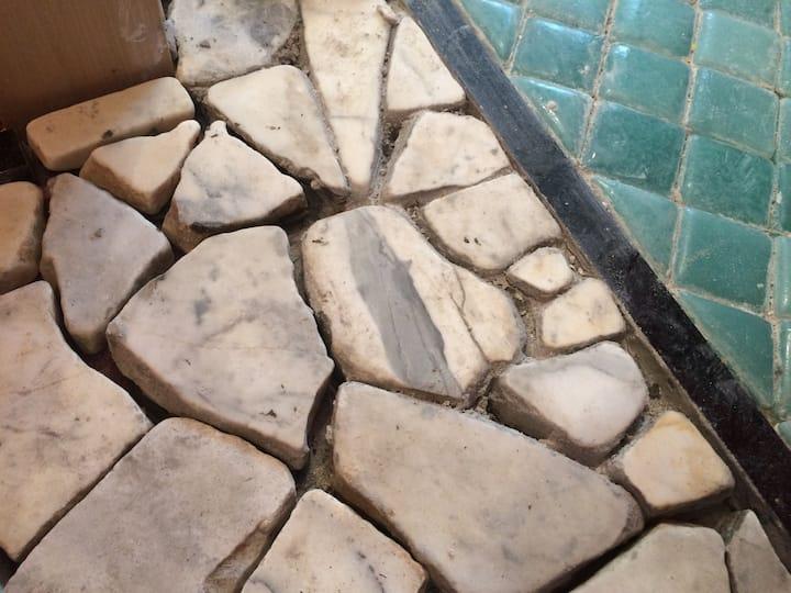Part of The Studio floor,  tumbled stone