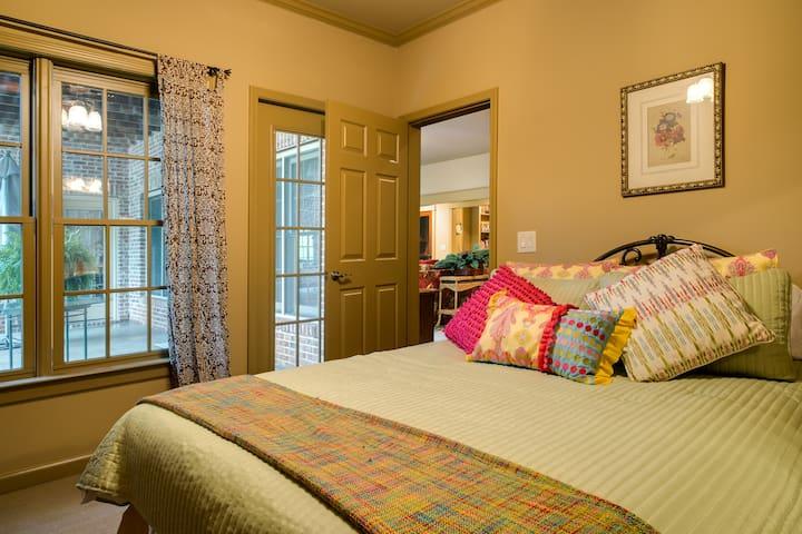 Queen size bed in bedroom number one.