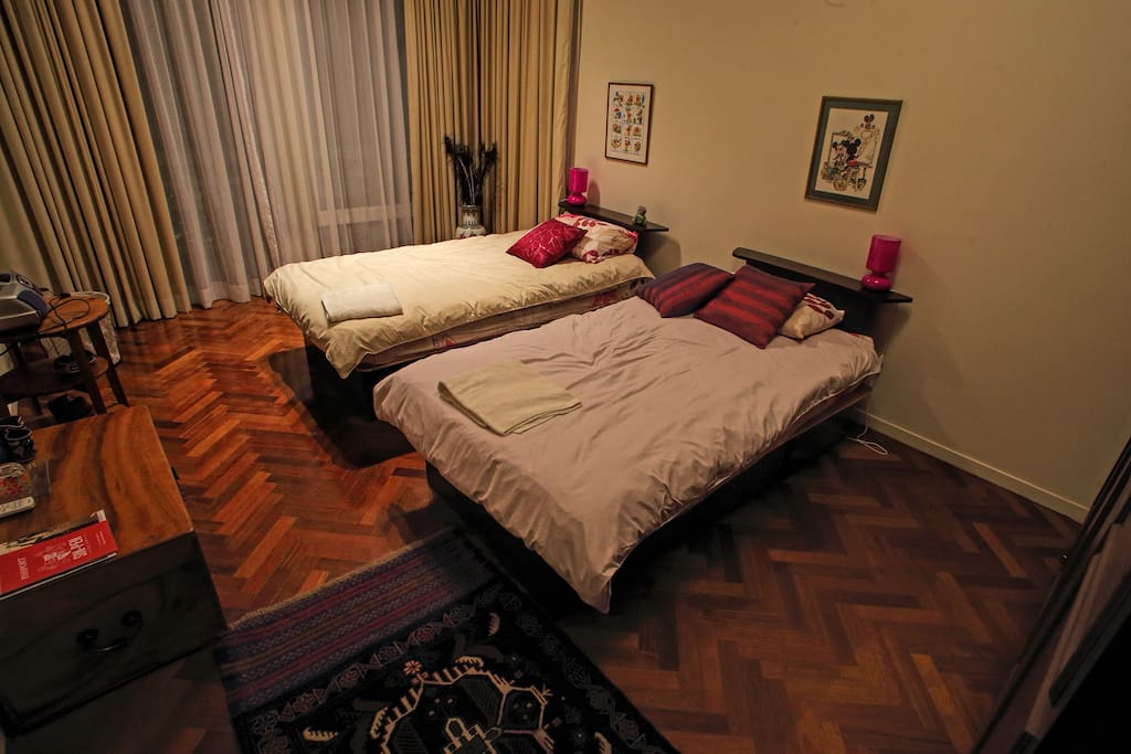 The second bedroom, with air-conditioning, twin beds and en-suite bathroom