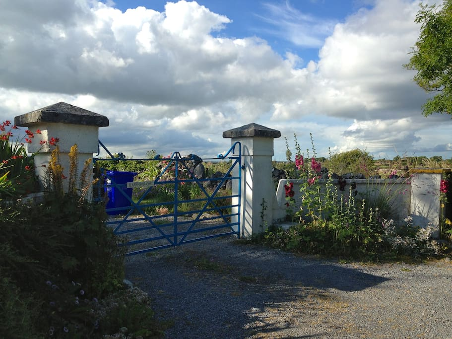 Look for the blue gate to enter into the parking area for the cottage.