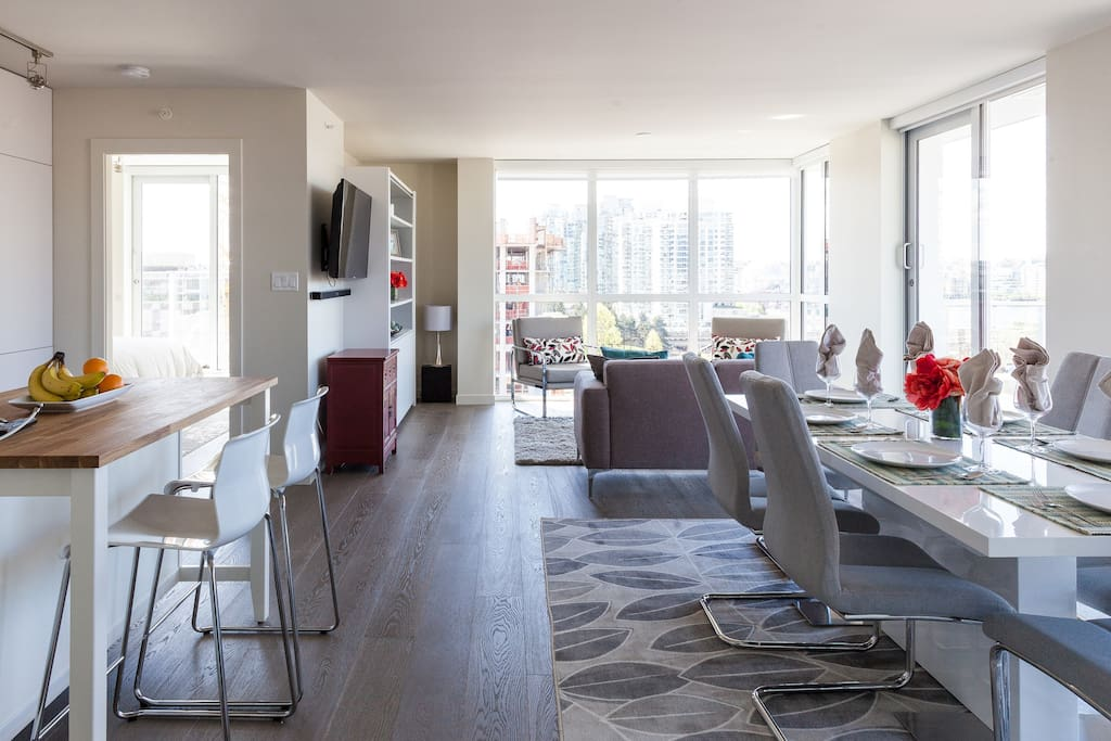 Very bright, large open living area. Modern decor-all new furniture and accessories. Sweeping views of Vancouver.