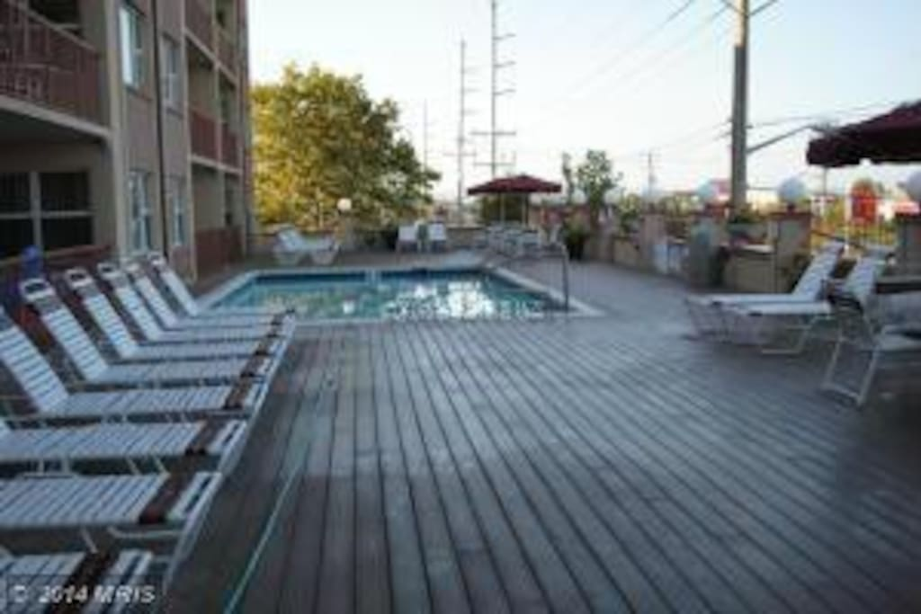 Large pool deck has plenty of seats, outdoor tables, and the afternoon sun!