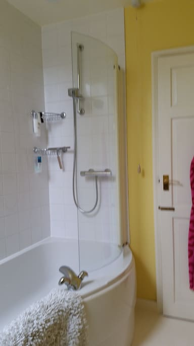Bath with power shower cabinet
