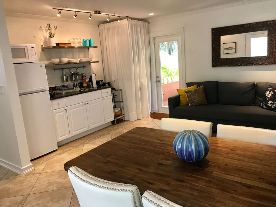 Living area with dinning table and a queen size sleeper sofa