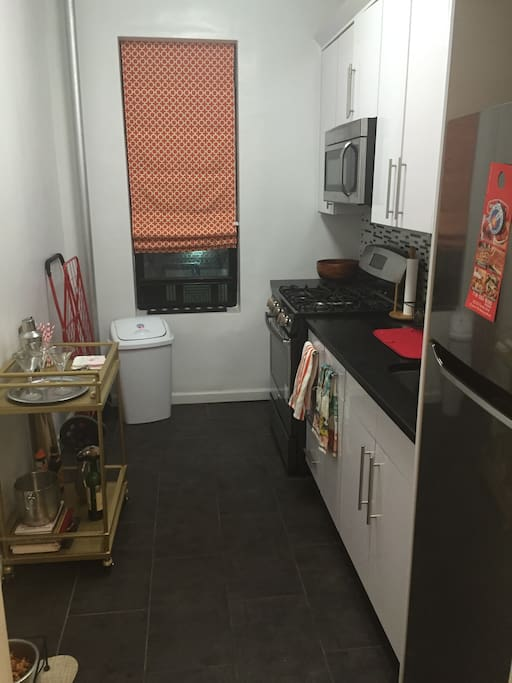 Fully equipped kitchen with plenty of room to cook! And a bar cart for mixing drinks.