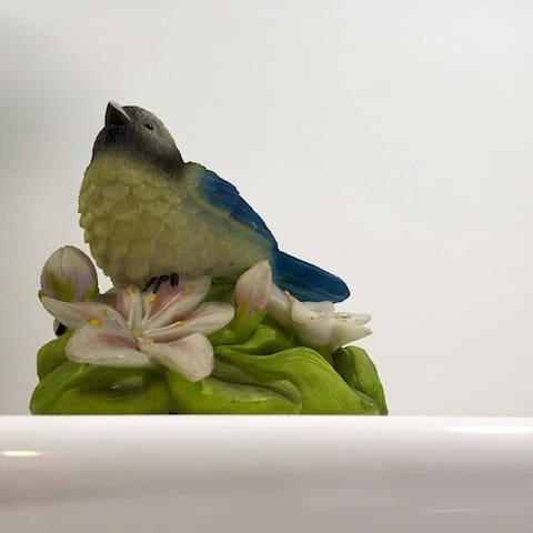 Cute tiny bird house in the center