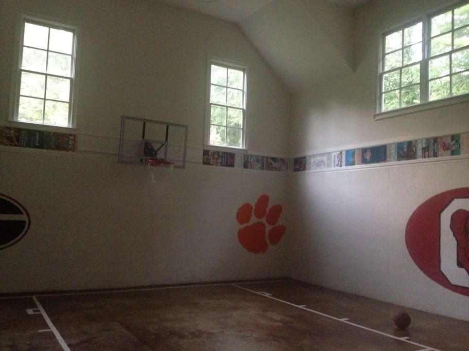 Attached indoor basketball gym with 2 bunk beds
