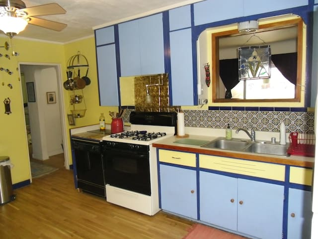 Stove, dishwasher and tiled area of kitchen.