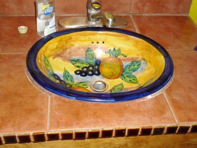 Bathroom hand-painted sink.