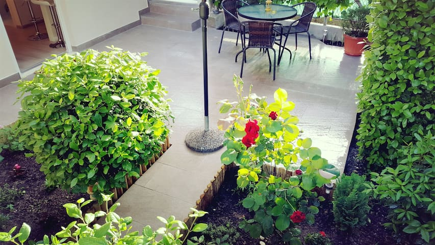 Sweet and private garden... enjoy your morning coffee in front of the door.