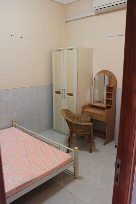 """Master bedroom has air con, 24""""cable TV and desk space with closet."""