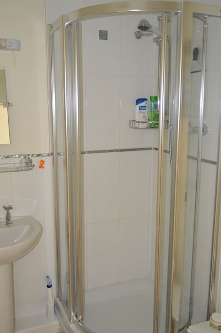 Shower room with loo and sink.