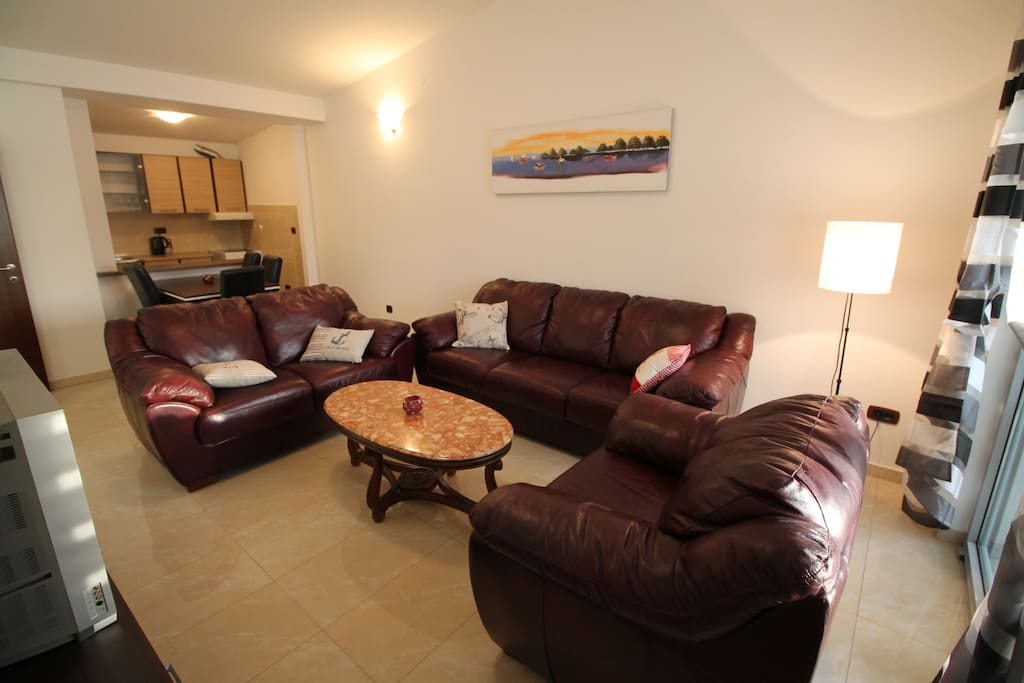 Living are with dining table and kitchen behind