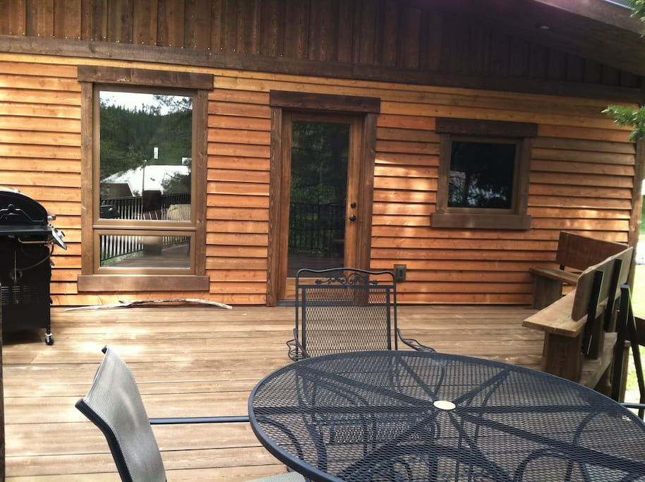 BBQ and deck area, entry to home.