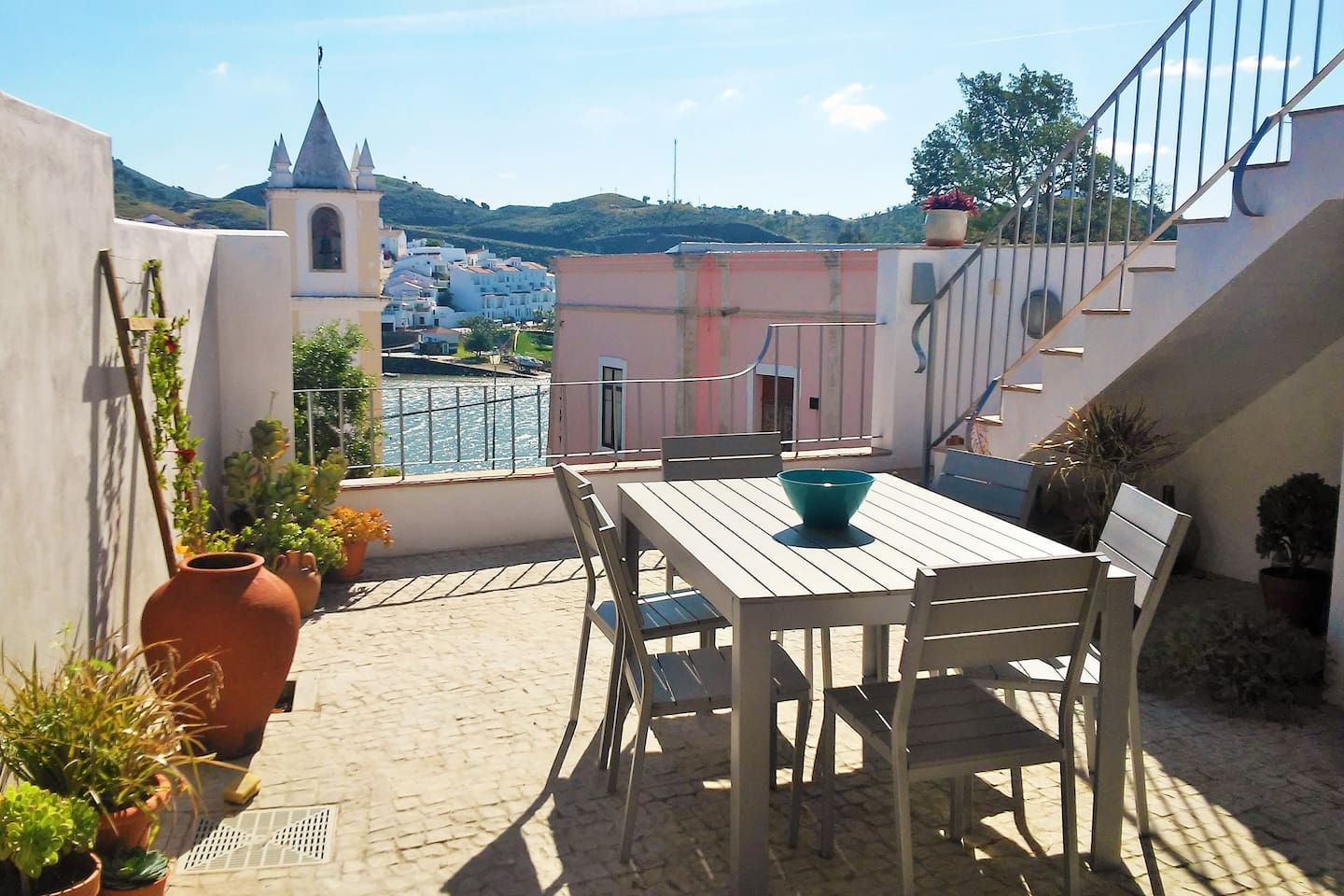 Enjoy dining out in the courtyard with views done to the church and river.