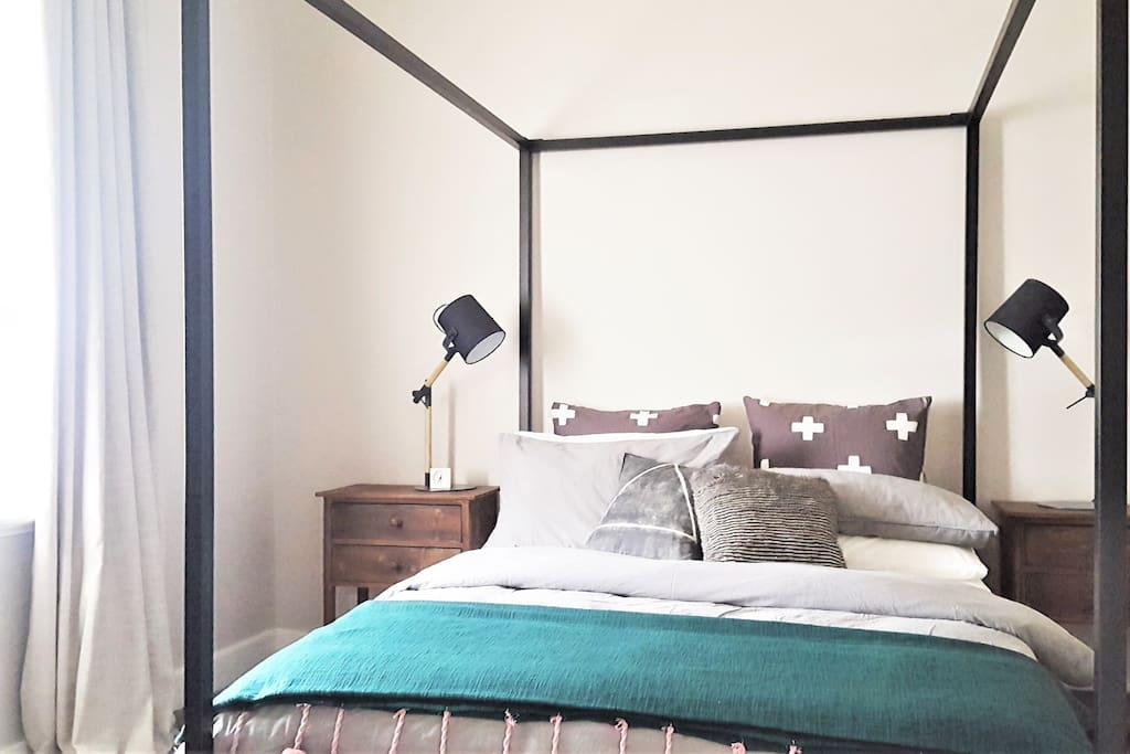 The luxurious main bedroom features a four post queen bed, ample hanging pace, privacy blind and generous block out drapes.