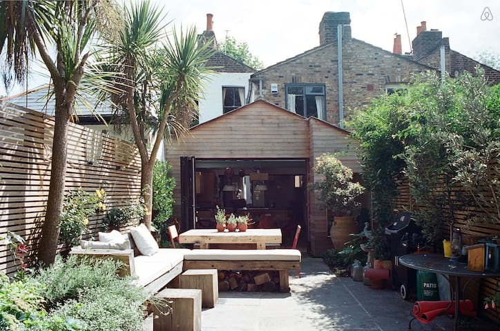 A comfy summer garden to sunbathe and relax in.