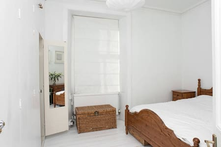 King size bed in bright apartment