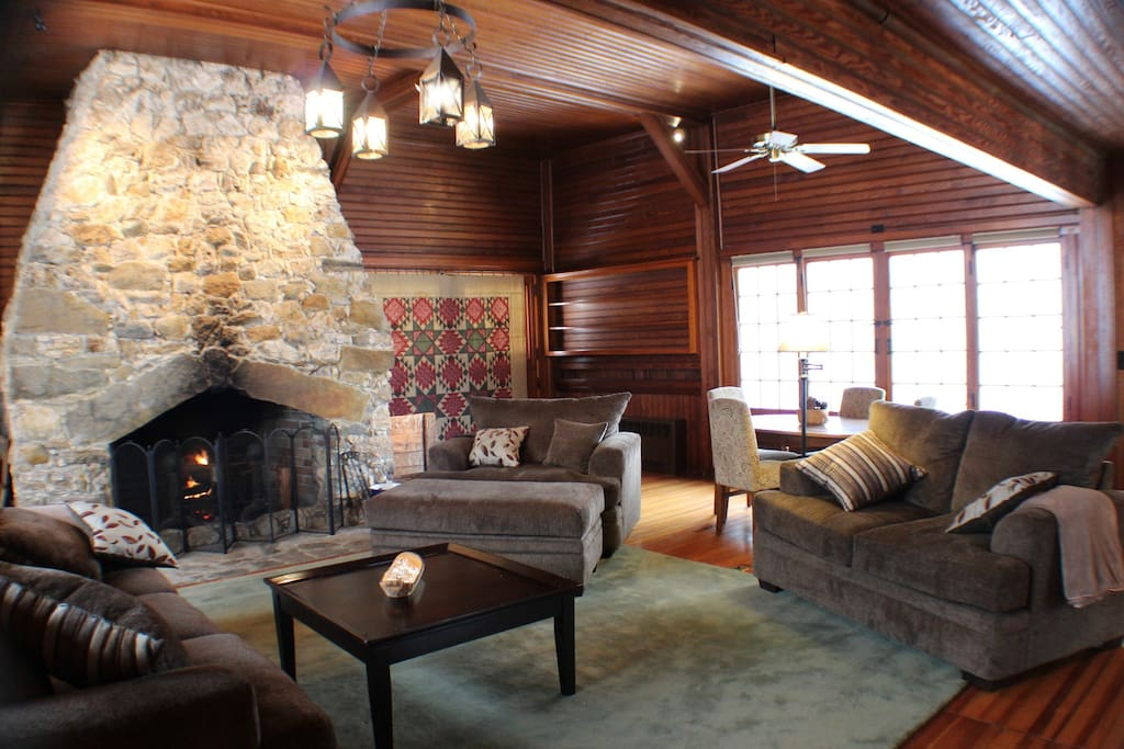 The Great Room is a 900 square foot room anchored by an enormous hand-laid fireplace.  The room also features hardwood appointments and large windows looking out at pastoral lands and the abutting forest.