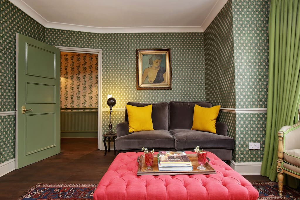 Living room with sage green accents and fun pops of colour