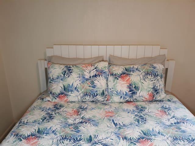 Master bedroom with queen bed and quiet fan.