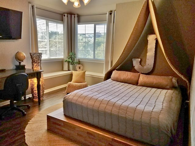 """You'll feel like you're glamping in this 14"""" pillow top queen bedroom with TV, desk, plenty of closet space and room-darkening blinds & curtains"""