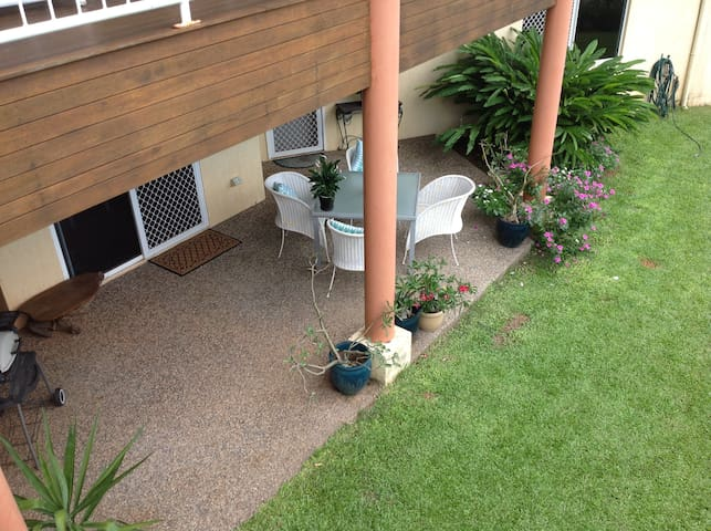 Private veranda and barbecue with garden access.